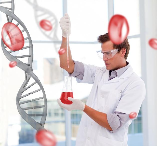 Cientista sério, pipetando um líquido em um testtube