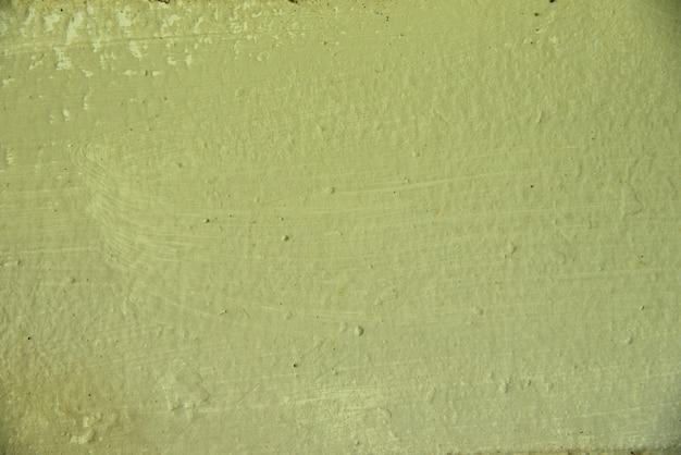 Cimento de cor amarela na textura e fundo