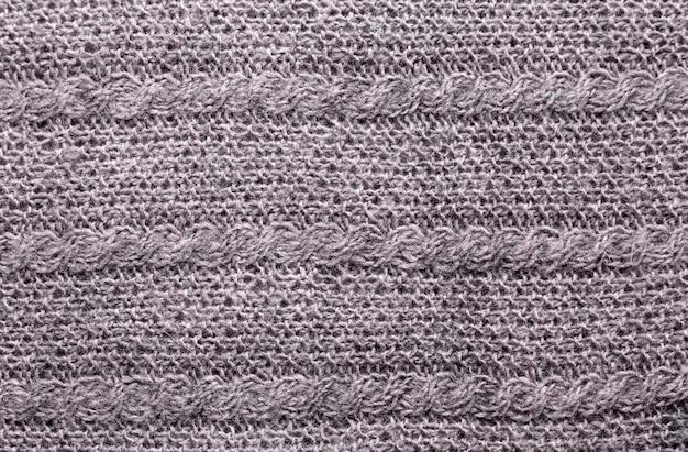 Cinza de tricô textura de lã. feito à mão quente.
