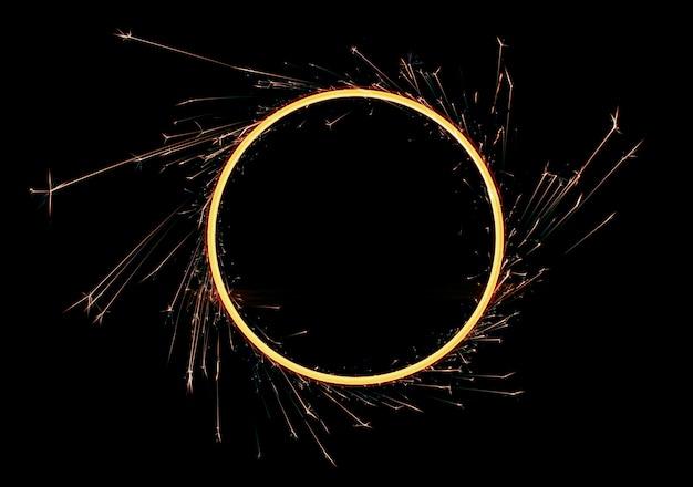 Círculo de faíscas, brilho em um preto