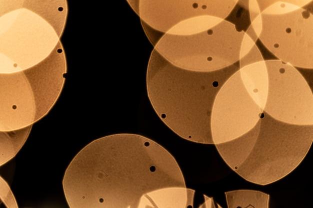 Círculo de luzes douradas na festa de ano novo