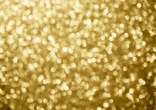 Círculos de bokeh de fundo abstrato ouro