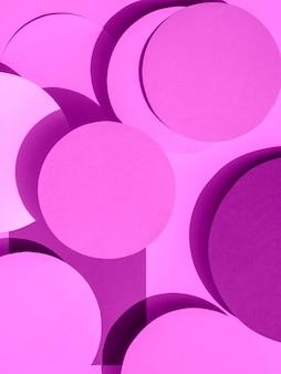 Círculos de papel violeta de fundo geométrico