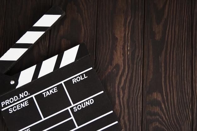 Claquete no conceito de madeira indústria cinematográfica, cinema, filme, globo de ouro e oscar como substrato
