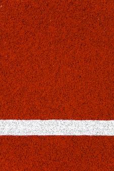 Close da pista de corrida do estádio vermelho