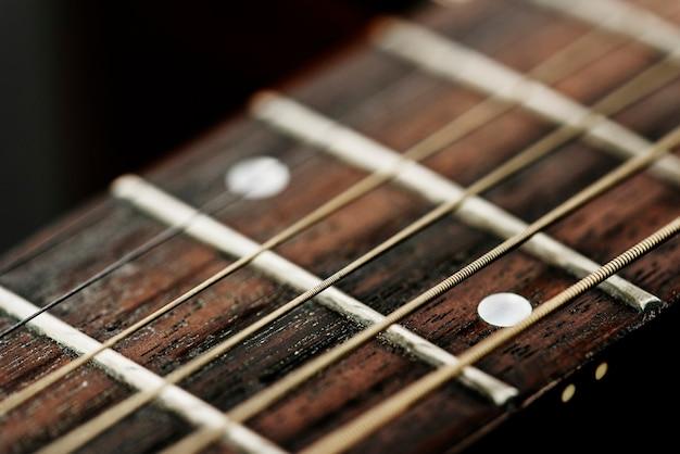 Close das cordas da guitarra