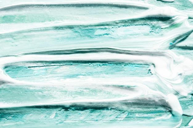 Close de pinceladas de tinta azul na superfície