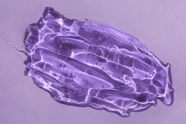 Close de produto cosmético de textura de ácido hialurônico com pequenas bolhas de glicerina ou mancha de gel