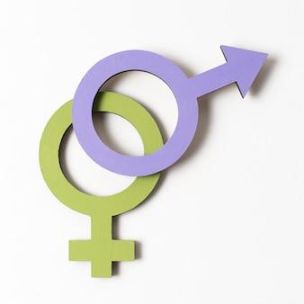Close de símbolos de gênero feminino e masculino