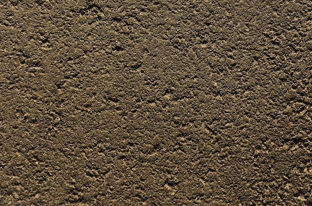 Close de uma estrada de asfalto texturizado fundo cinza