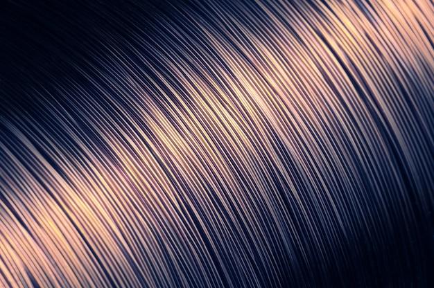 Close de uma grande meada de fio de ferro fundido cinzento na produção de peças técnicas.