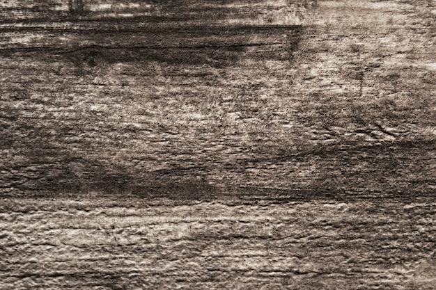 Close de uma prancha de madeira modelado fundo