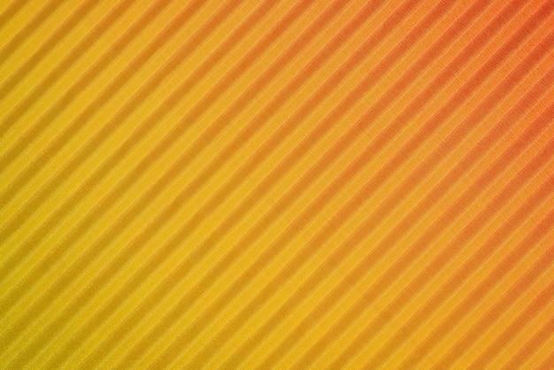 Close-up amarelo com papel laranja ondulado