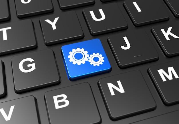 Close-up botão azul com sinal de engrenagens no teclado preto