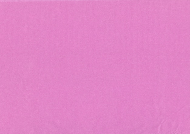Close up cor-de-rosa da textura do papel de crepe do ofício.