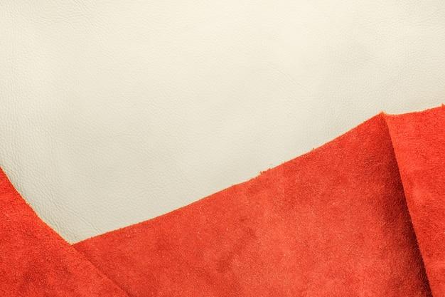 Close-up couro branco e couro camurça laranja dividir duas seções