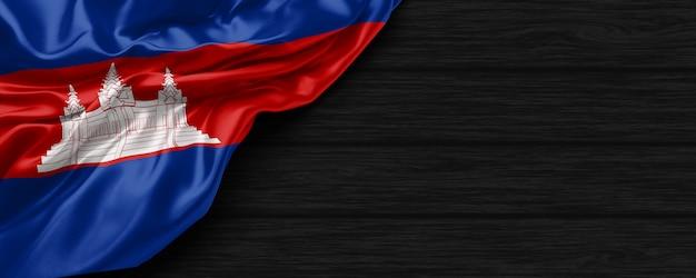 Close-up da bandeira dos estados unidos do camboja no fundo preto de madeira renderização em 3d