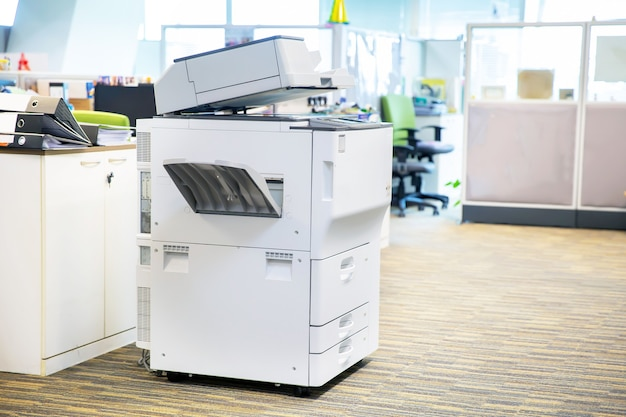 Close-up da copiadora no local de trabalho.