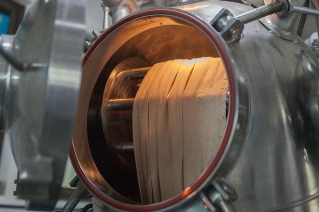 Close-up da fábrica de têxteis máquina a vapor