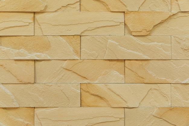Close-up da parede de tijolo de cor de chocolate ao leite