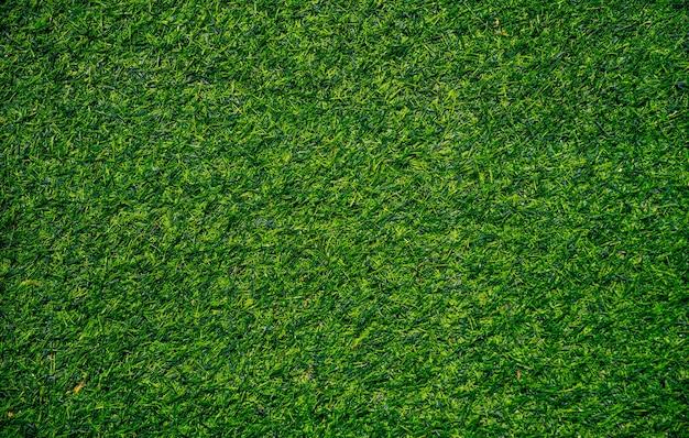 Close-up da textura da grama artificial, fundo da grama artificial.