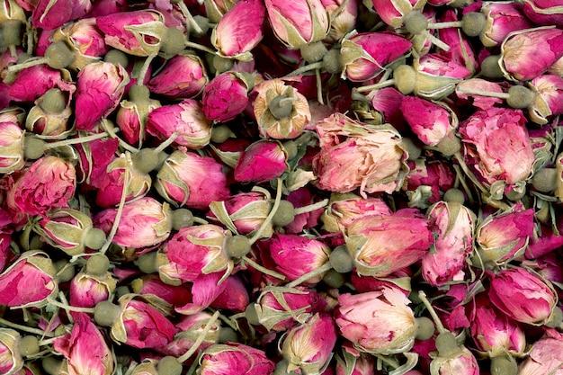 Close up da textura do fundo dos botões de rosa secos. foto macro.
