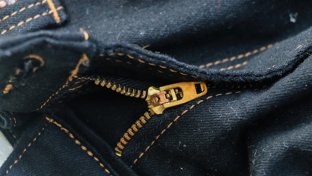 Close-up de calças de zip de latão jeans textura de fundo