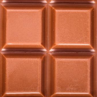 Close up de chocolate ao leite como pano de fundo