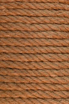 Close-up de corda enrolada. escumalha da corda enrolada em linhas. textura da corda felpuda