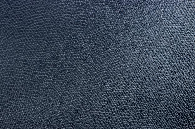 Close-up de couro artificial preto, textura, plano de fundo