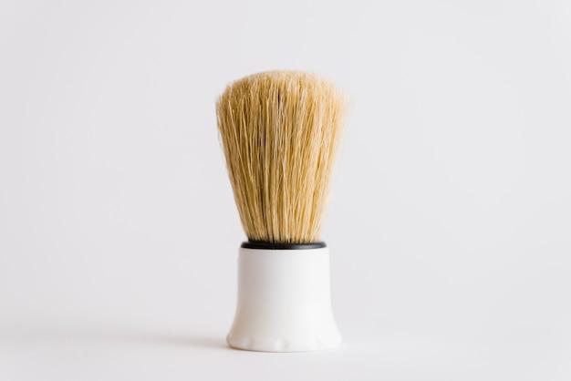 Close-up, de, escova raspando, isolado, branco, fundo