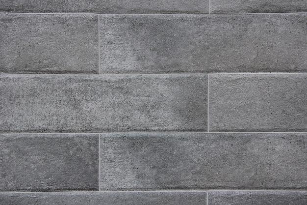 Close-up de fundo de textura de parede de bloco de mármore cinza.