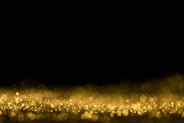 Close up de glitter dourado com espaço de cópia