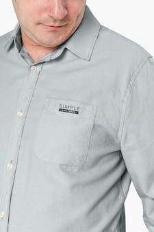 Close-up de homem vestindo camisa bege de manga comprida