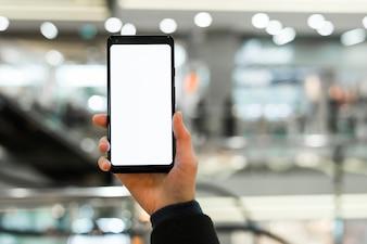 Close-up, de, mão, mostrando, branca, em branco, exposição, de, esperto, telefone, em, centro comercial