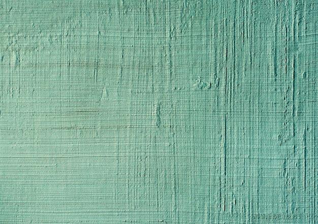 Close-up de massa de vidraceiro texturizada azul ou verde. estuque venetian da textura de superfície do vintage ou do grunge no teste padrão da parede.