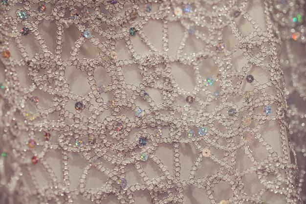 Close-up de pano bordado artesanato com fundo de desenho tradicional