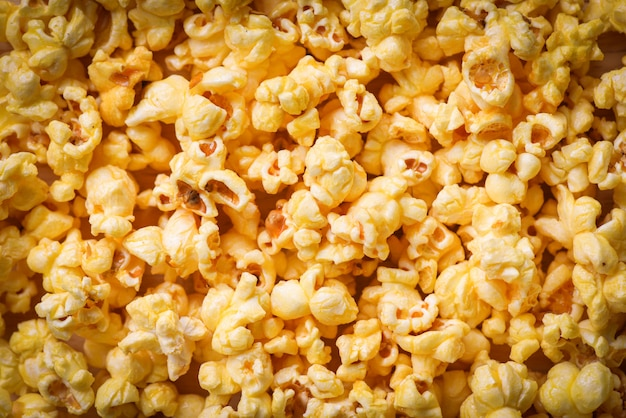 Close-up de pipoca - doce manteiga pipoca textura fundo vista superior