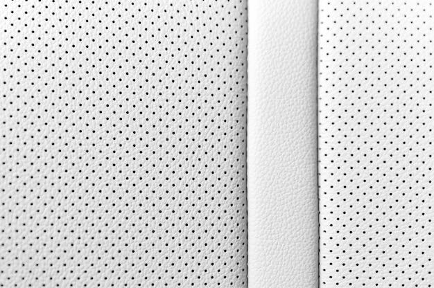 Close up de textura de couro branco com buracos negros