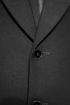Close-up de um casaco de terno de negócios de botão