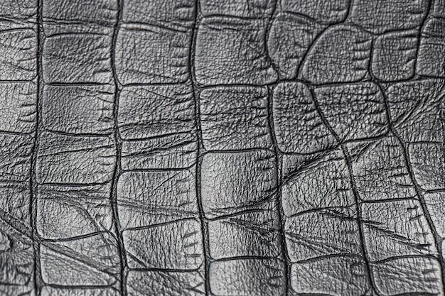 Close-up de um fundo de couro preto da textura.