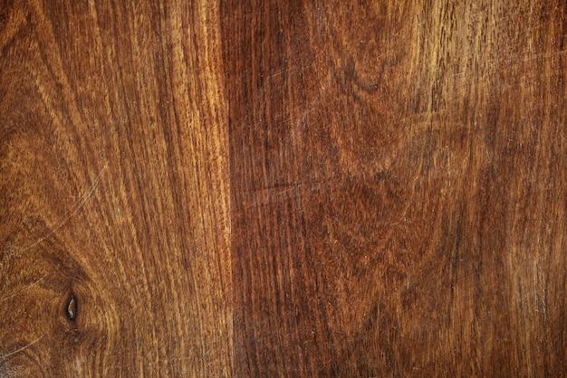 Close-up de um fundo texturizado de tábua de madeira marrom