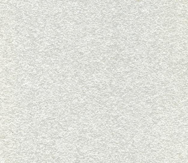 Close up de um material esponjoso sintético branco usado para isolamento