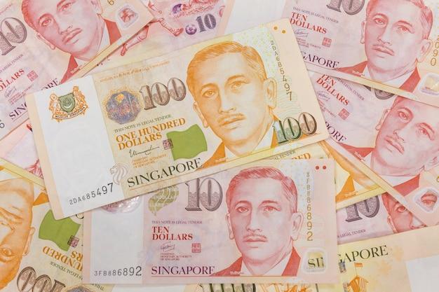 Close-up de um monte de dinheiro de singapura e textura de fundo ou padrão