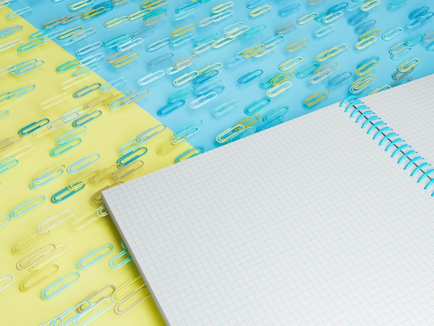 Close up de um notebook com clipes flutuando