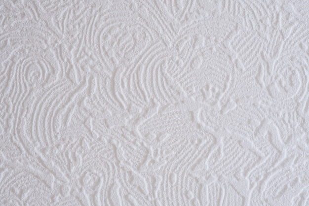 Close-up de um padrão branco com nervuras em uma placa do teto.
