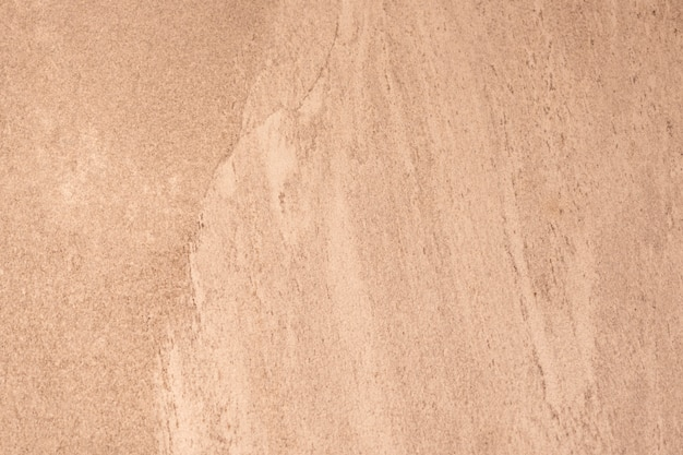 Close-up de uma textura de parede áspera laranja