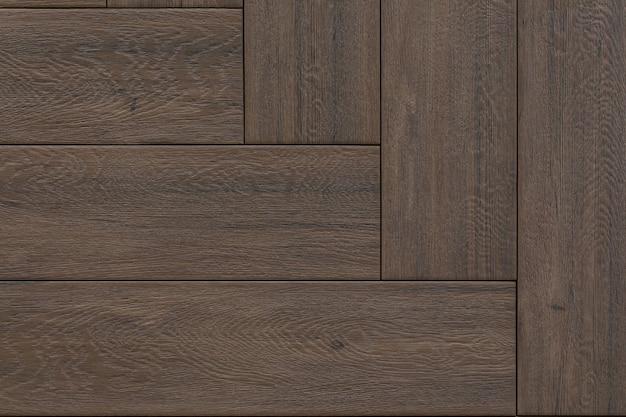 Close-up do assoalho de madeira, espaço vazio.