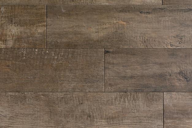 Close-up do assoalho de madeira marrom.