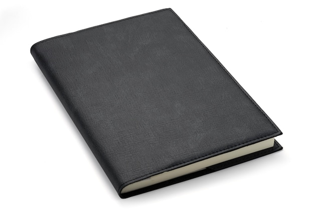 Close up do caderno do preto do couro da vista superior no fundo branco. isolado com a foto do trajeto de grampeamento.